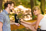 Hiker young couple in nature preparing to hike - 223388538