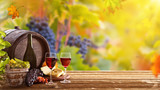 Vines with grapes and old cask on vintage wooden table. - 223390766