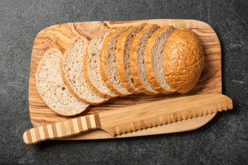 Fresh sliced bread on wooden cutting board