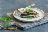 Anchovies in olive oil with fresh dill. - 223419169