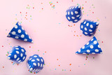 Birthday paper caps with confetti on pink background - 223424170