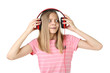 Beautiful young girl with headphones on white background