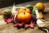 Diverse assortment of pumpkins on a wooden background. Autumn harvest - 223428741