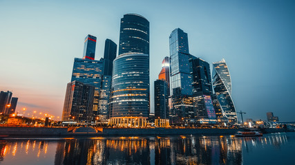 Panoramic view of Moscow city and Moskva River after sunset. New modern futuristic skyscrapers of Moscow-City - International Business Center