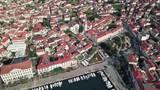 Flying above town of Vela Luka on island Korcula in Croatia. - 223437173