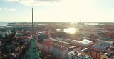 Vertical tracking shot of a church in Helsinki with the sun behind. - 223447124