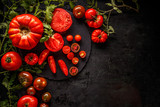 Fresh red sliced and whole tomatoes - 223479134