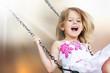 Leinwanddruck Bild - Little child blond girl having fun on
