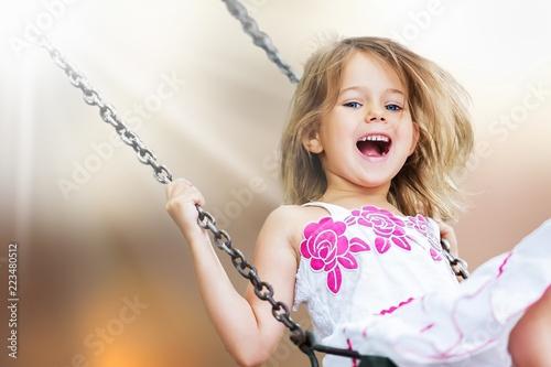 Leinwanddruck Bild Little child blond girl having fun on
