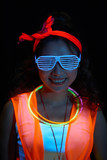 Portrait of happy young stylish woman in bright neon colors