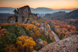 Magnificent morning view of the Belogradchik rocks in Bulgaria, lit by the autumn sun - 223489537