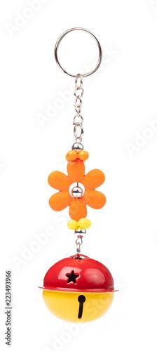 keychain dzwon z kwiatem na białym tle.