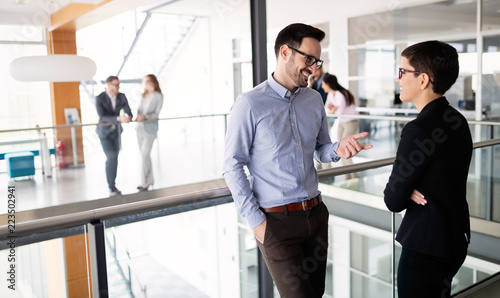 Business colleagues having conversation during coffee break - 223502941