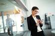 Leinwandbild Motiv Busy businesswoman working in a cafe talking on the phone