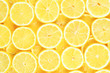 Leinwandbild Motiv A slices of fresh juicy yellow lemons.  Texture background, pattern.