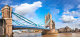 Tower Bridge in London, England, on a bright sunny day under gorgeous sky with clouds