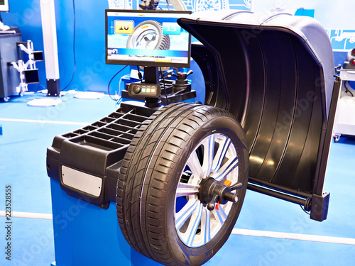Stand for balancing wheels of car - 223528555