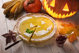 Pumpkin cake, cooked for the celebration of Halloween and decorated with sugar powder. Food photography - 223531526