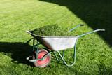 Electric lawn mower on green grass closeup - 223532543
