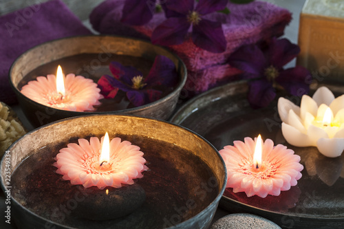Decorative spa still life with soap, towels, flowers and candles, perfect for spa, well-being, beauty and relaxation themes