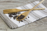 Rustic kitchen still life with linnen tea towel and wooden spoon and fork - 223549540