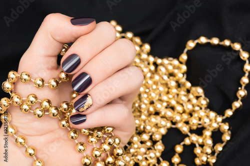Beautiful female hand with purple nail design - 223561712