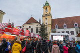 View on Christmas market on the Main square in Bratislava,Slovakia. Stara radnica and Bratislava Christmas Market, blurred people can be seen.