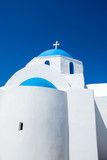 Cycladic greek orthodox church on Paros island, Greece. White cross against blue sky - 223592170