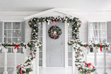 Christmas morning. porch a small house with a decorated door with a Christmas wreath. Winter fairy tale. - 223605575