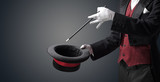 Illusionist white hand wants to conjure with magic wand from a black cylinder something - 223618779