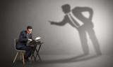 Little man working and a big shadow arguing with him  - 223624583