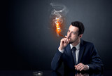 Businessman smoking with inferno effect. - 223626393