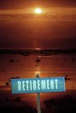 Retirement sign at sunset with lake destination - 223634763