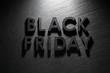 Quadro Black Friday text on black slate background