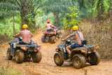 PHUKET, THAILAND - AUGUST 23 : Tourists riding ATV to nature adventure on dirt track on AUGUST 23, 2014, Thailand.