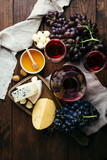 Cheese and wine, Decanter and glasses, wooden background, appetizer, grapes - 223688112