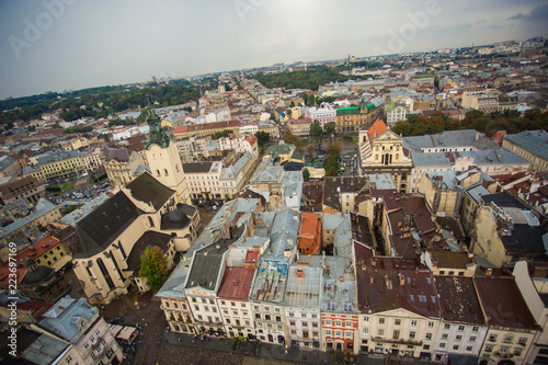 Aerial view old european city with rainy clouds on background - 223697169