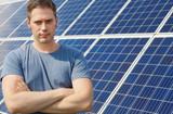 Man standing in front of solar panels. Renewable energy. - 223704562