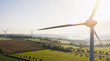 Leinwanddruck Bild - Wind turbine and agricultural fields - Energy Production with clean and Renewable Energy - copyspace for your individual text