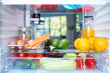 Opened fridge from the inside full of vegetables, fruits and other groceries. - 223723170
