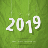 Paper 2019 digits white on a crumpled paper green background. - 223730963
