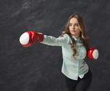 Woman in red boxing glove punch to the goal - 223735733