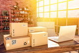 Internet shopping, online purchases, e-commerce and package delivery concept, cardboard boxes on the desk table in a modern interior