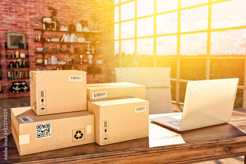 Internet shopping, online purchases, e-commerce and package delivery concept, cardboard boxes on the desk table in a modern interior - 223744129