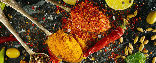 Variety of spices and herbs on kitchen table. Wide photo. © alinamd