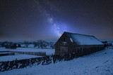 Vibrant Milky Way composite image over landscape of Snow covered barn in Peak District in England - 223792160