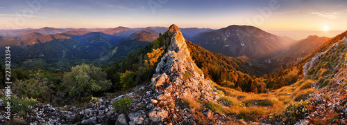 Rocky Panorama of sunset in mountain valley landscape.