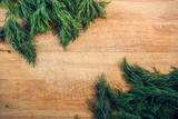 two bundles of dill on a wooden cutting Board. the view from the top. focus on copy space.flat lay - 223843752
