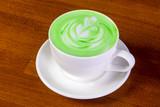 Green cappuccino with cream