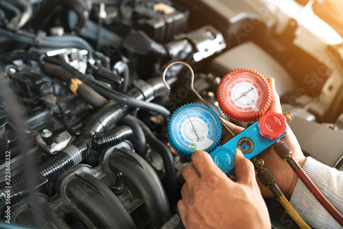 monitor tool on car engine ready to check and fixed car air conditioner system in car garage